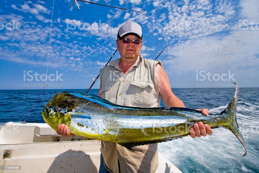 Middle Aged Caucasian Fisherman with Mahi-Mahi, Dorado or Dolphin Fish stock photo