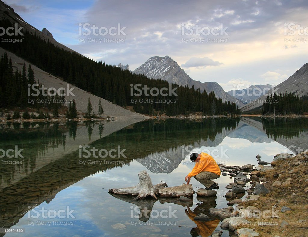 Middle Aged Caucasian Man Praying in the Mountains royalty-free stock photo