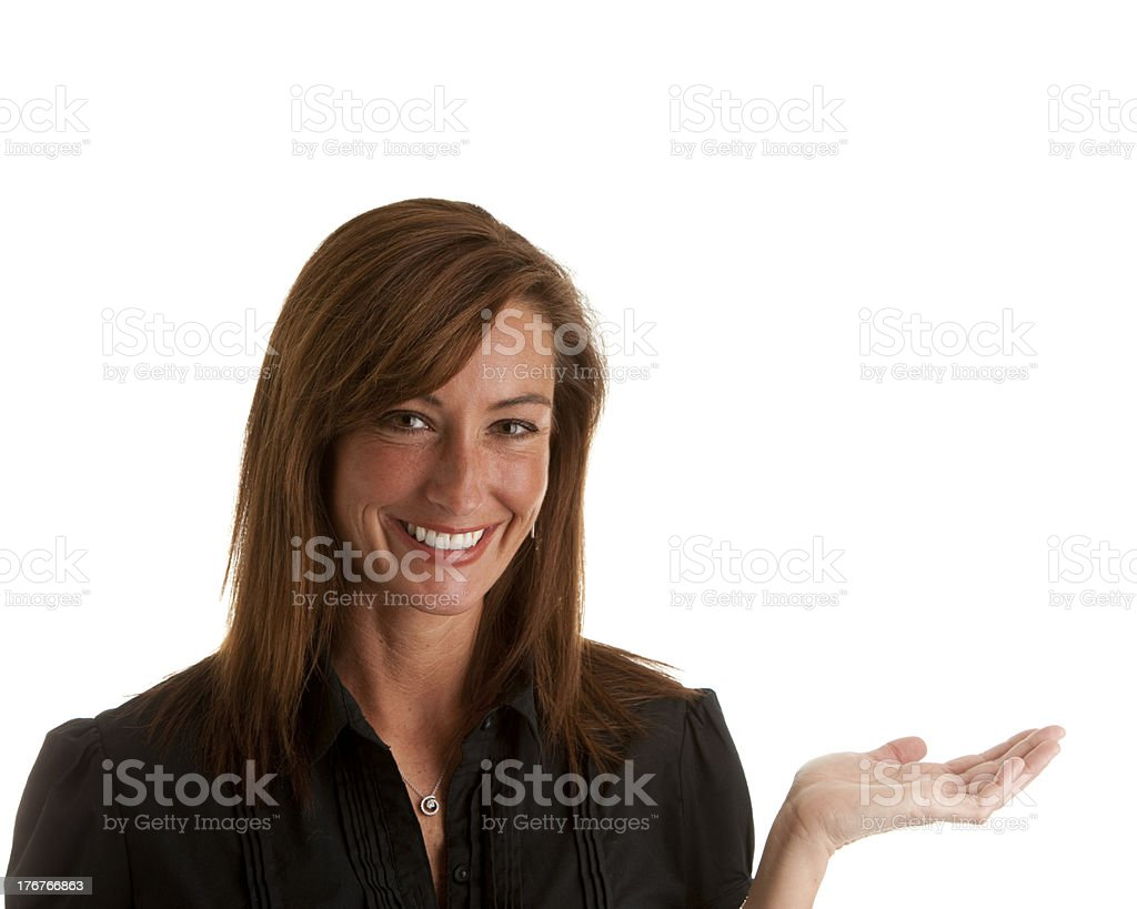 Middle Aged Caucasion Woman Smiling with Hand Out to Display royalty-free stock photo