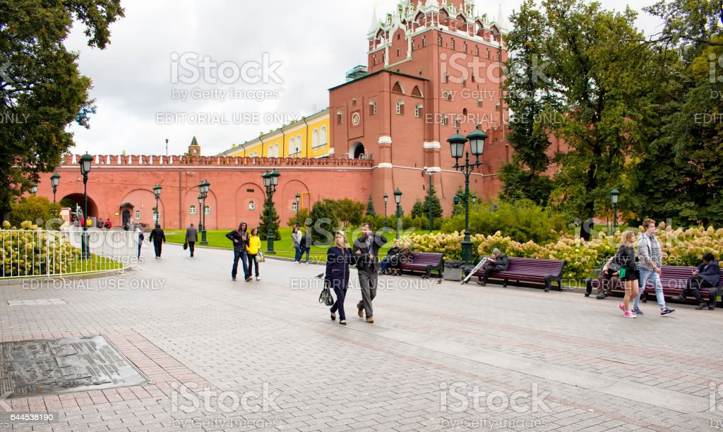 Middle aged couple and some other people walk stock photo