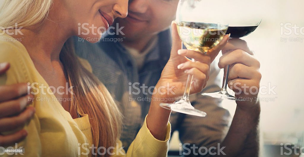 Middle aged couple drinking wine. stock photo