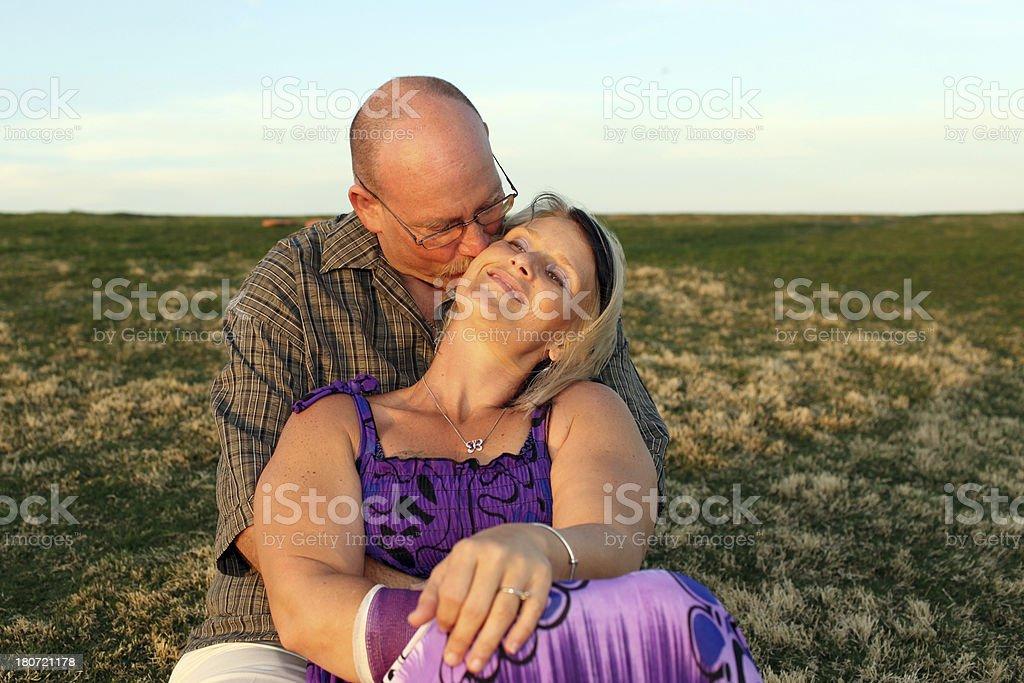 Middle Aged couple enjoying a Sunset. royalty-free stock photo
