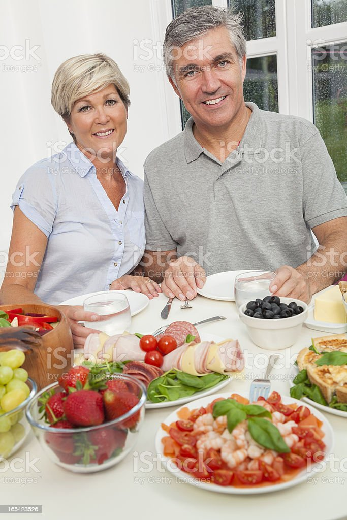 Middle Aged Couple Healthy Eating Salad Table royalty-free stock photo