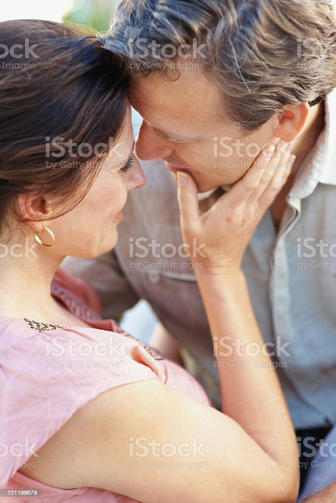 Middle aged couple looking into eachothers eyes royalty-free stock photo