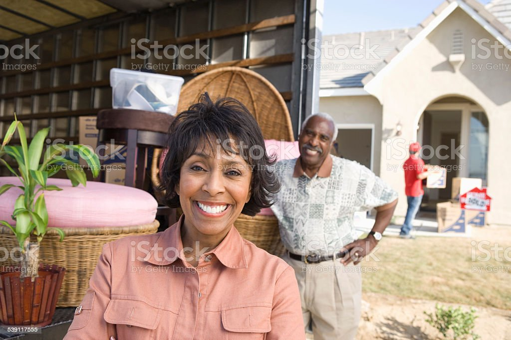 Middle aged couple moving into New Home stock photo