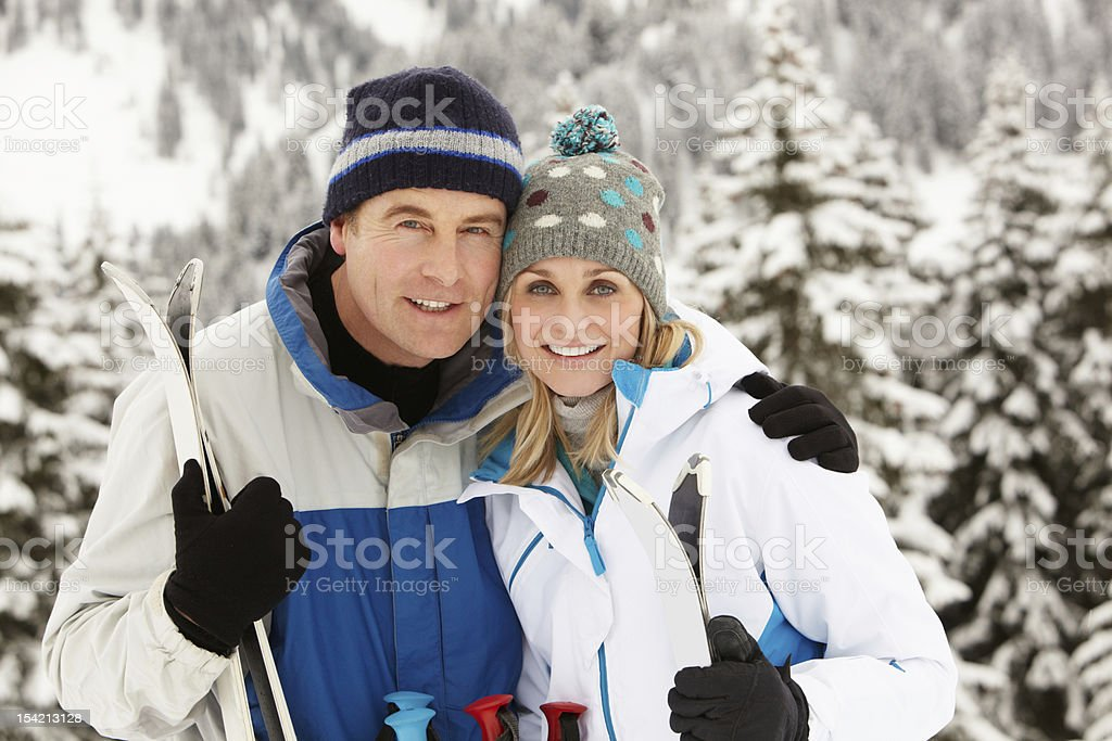 Middle Aged Couple On Ski Holiday In Mountains stock photo