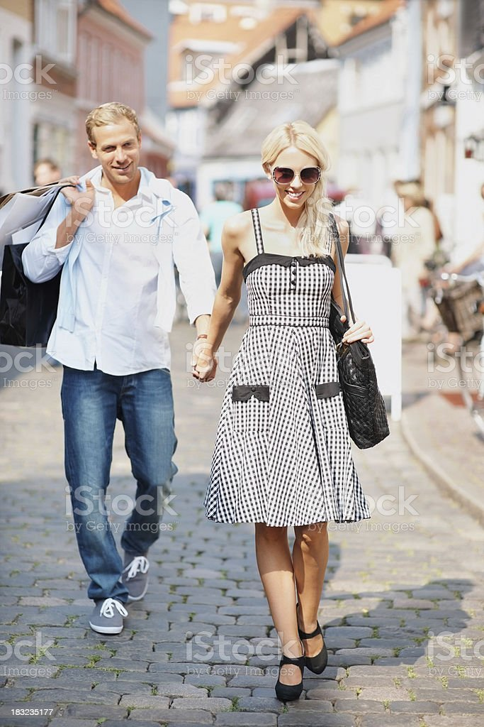 Middle aged couple walking with shopping bags - outdoor royalty-free stock photo