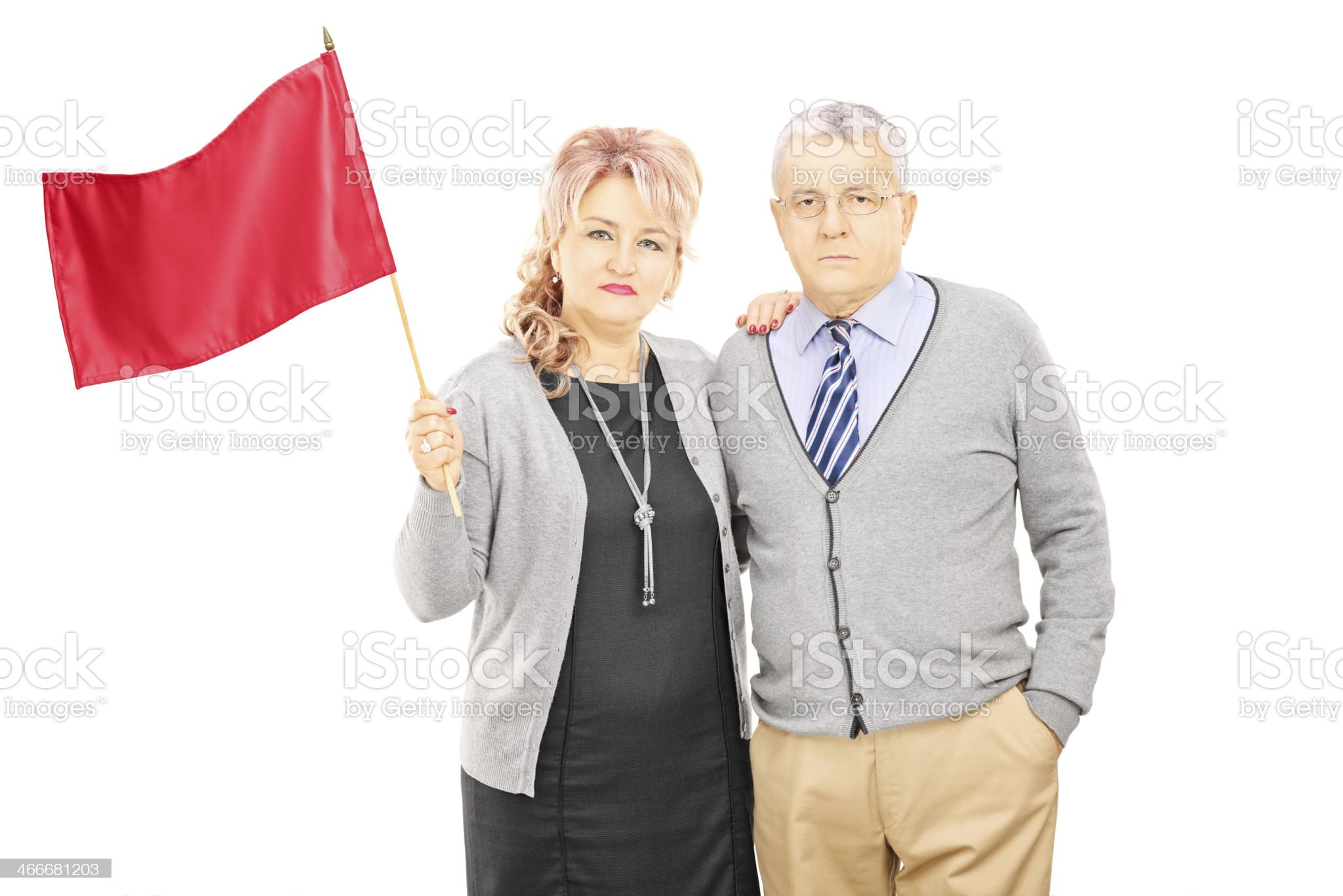 Middle aged couple waving a red flag royalty-free stock photo