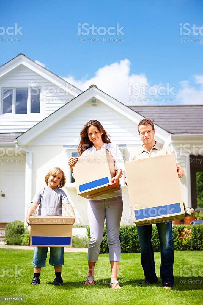 Middle aged couple with their child moving to new house royalty-free stock photo