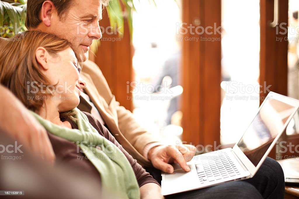 Middle aged couple working on a laptop royalty-free stock photo