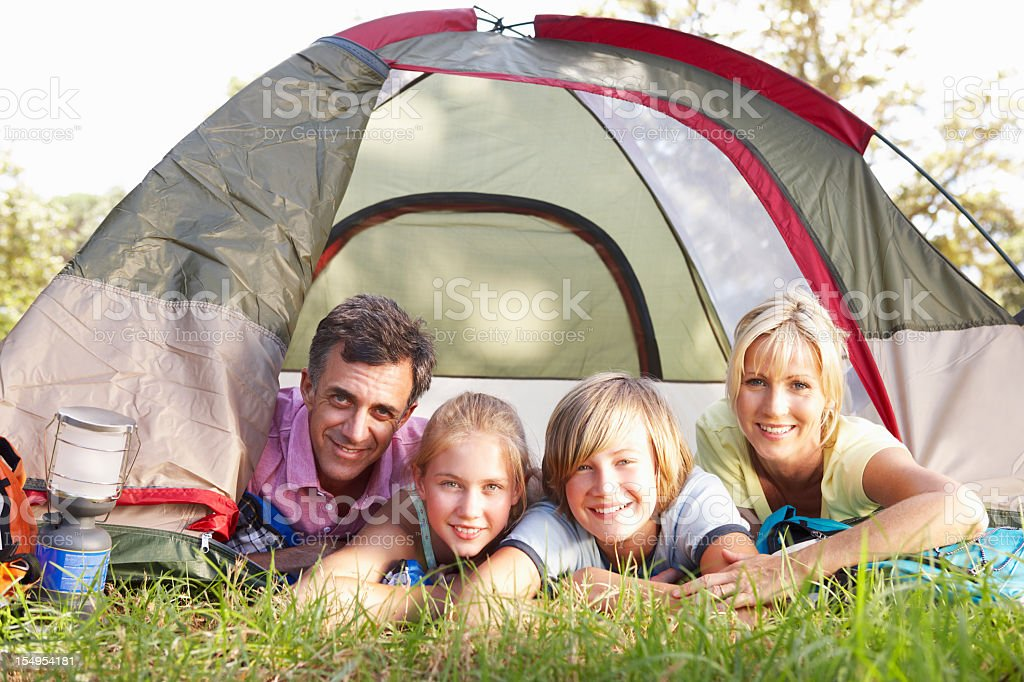 Middle Aged Family On Camping Holiday In Countryside royalty-free stock photo