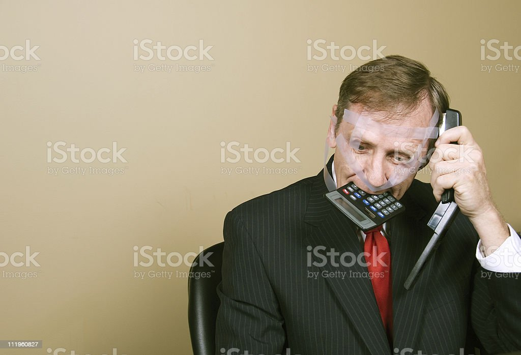 Middle aged frustrated businessman going crazy with work stock photo