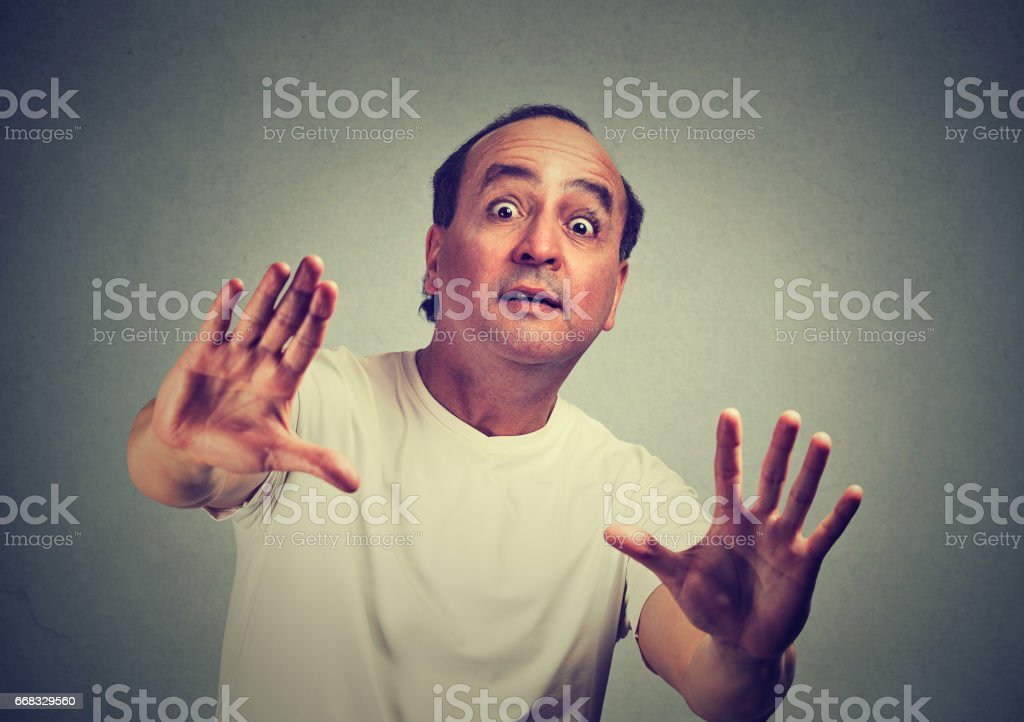 Middle aged handsome man scared with shocked facial expression stock photo