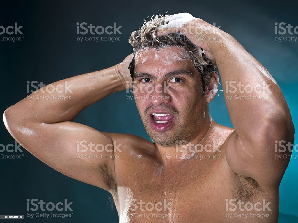 Middle aged Hispanic man showering royalty-free stock photo