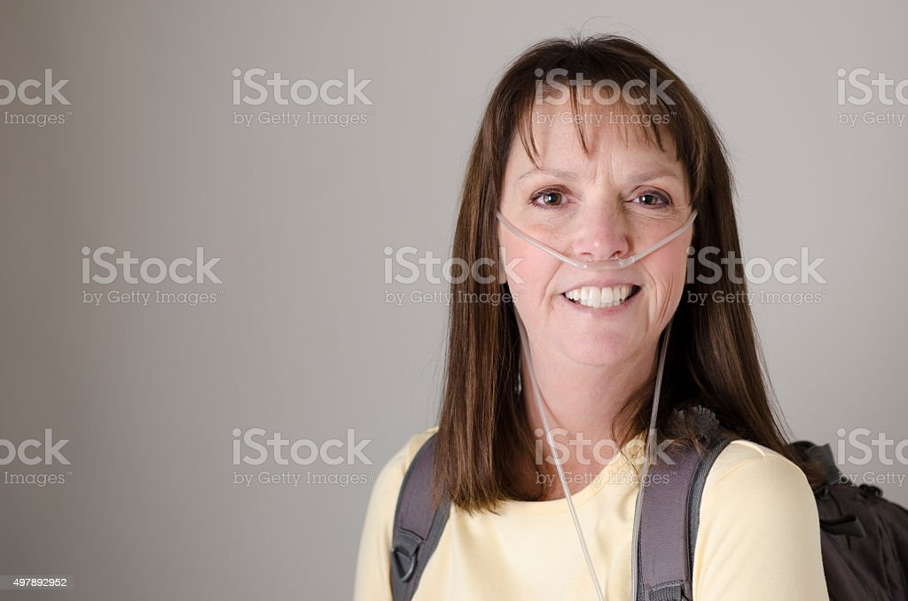 Middle aged lady wearing oxygen therapy equipment stock photo