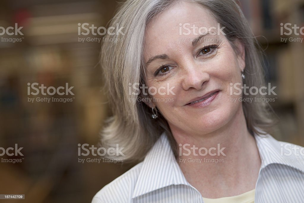 Middle aged lady with gray hair standing royalty-free stock photo