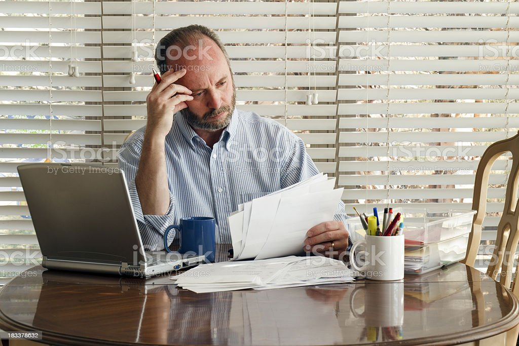 Middle Aged Male Homeowner Struggles With Paying Bills Debt Unemployment stock photo