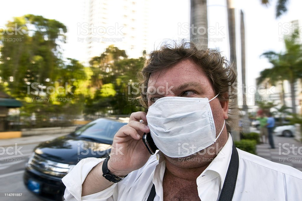 Middle aged male in Mexico City masked to prevent swine flu royalty-free stock photo