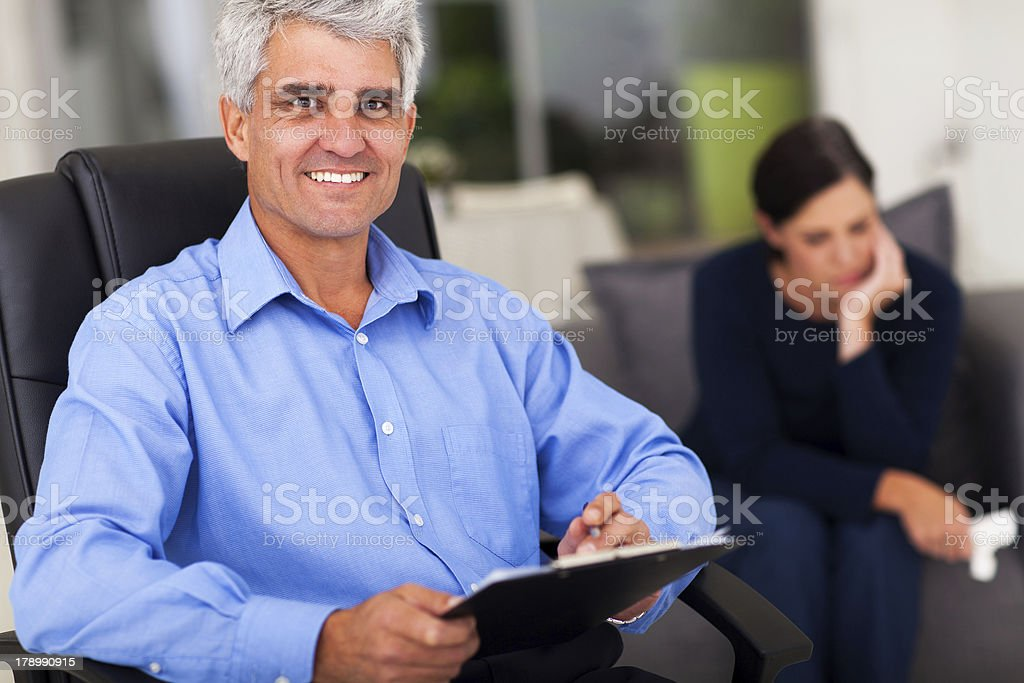 middle aged male psychologist in office royalty-free stock photo