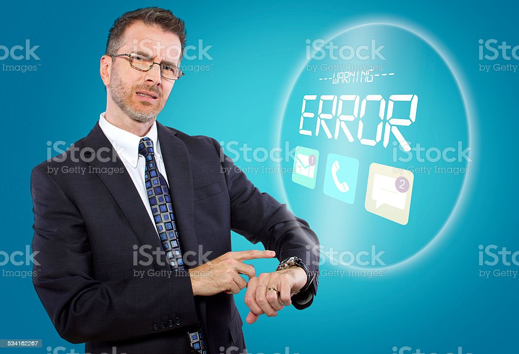 Middle Aged Male Technophobe with Smart Watch stock photo