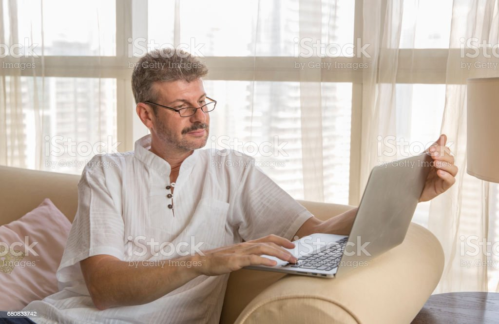 middle aged man and computer stock photo