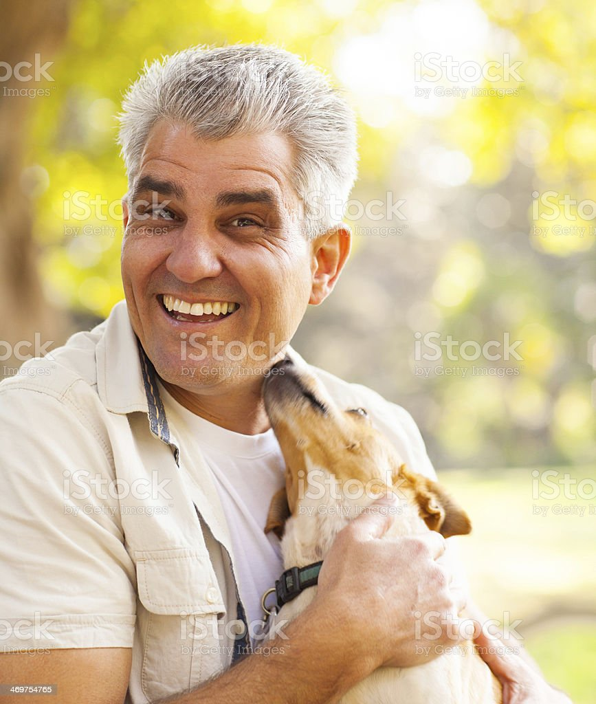 middle aged man and pet dog stock photo