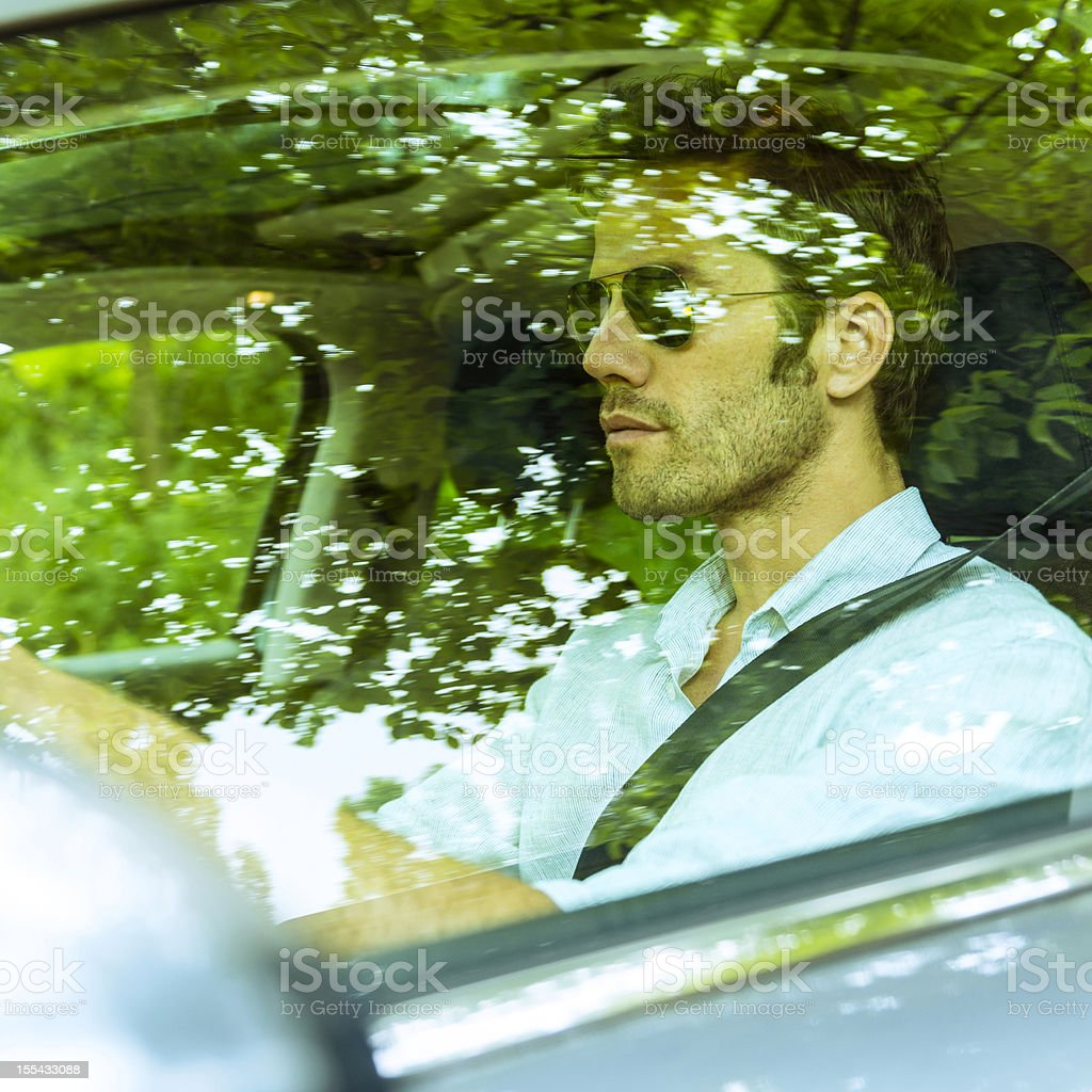 Middle aged man driving a car royalty-free stock photo