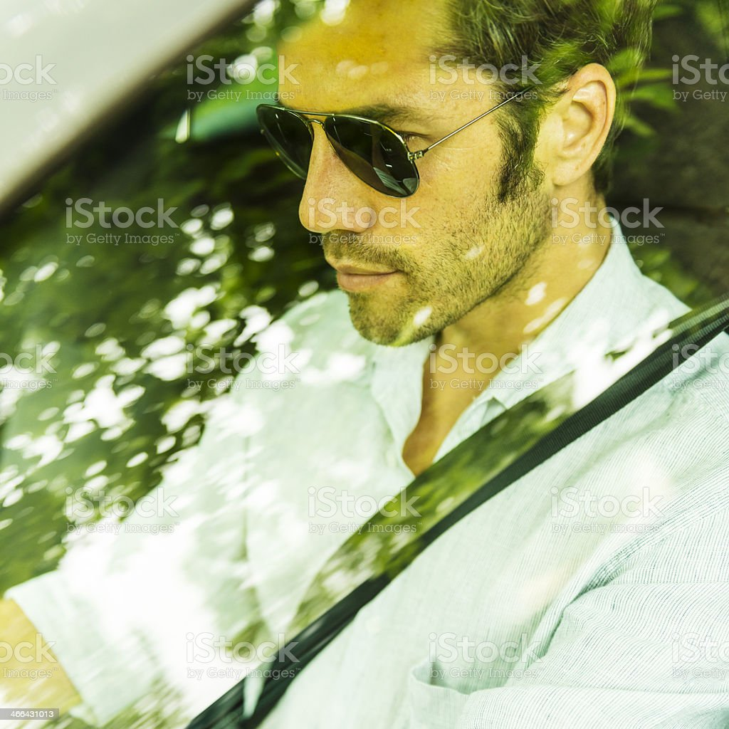Middle aged man driving a car stock photo