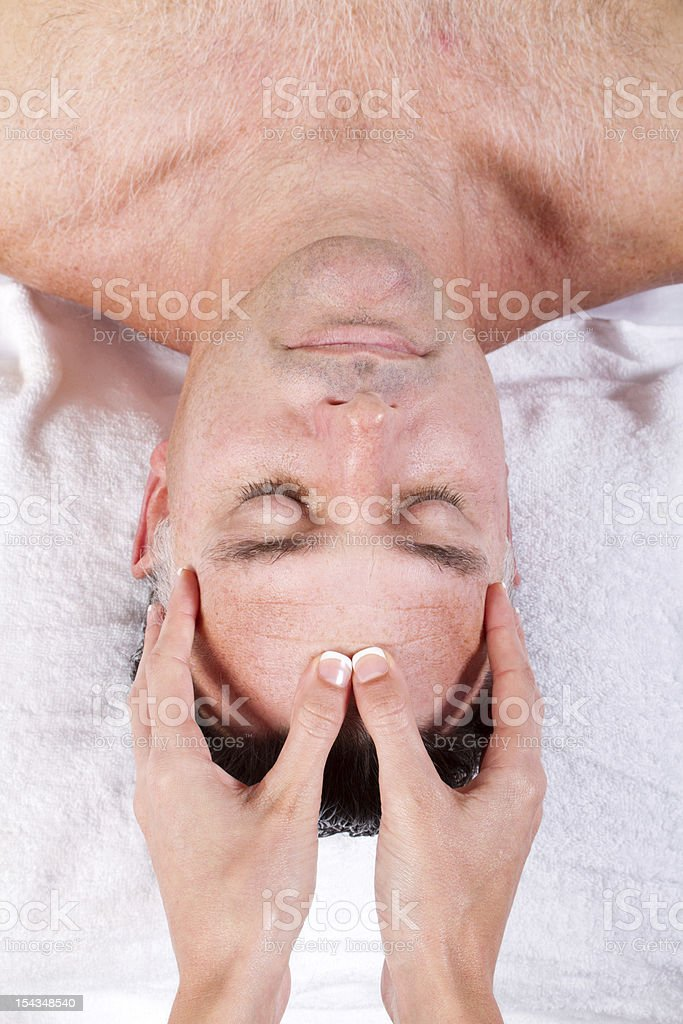 middle aged man facial massage royalty-free stock photo