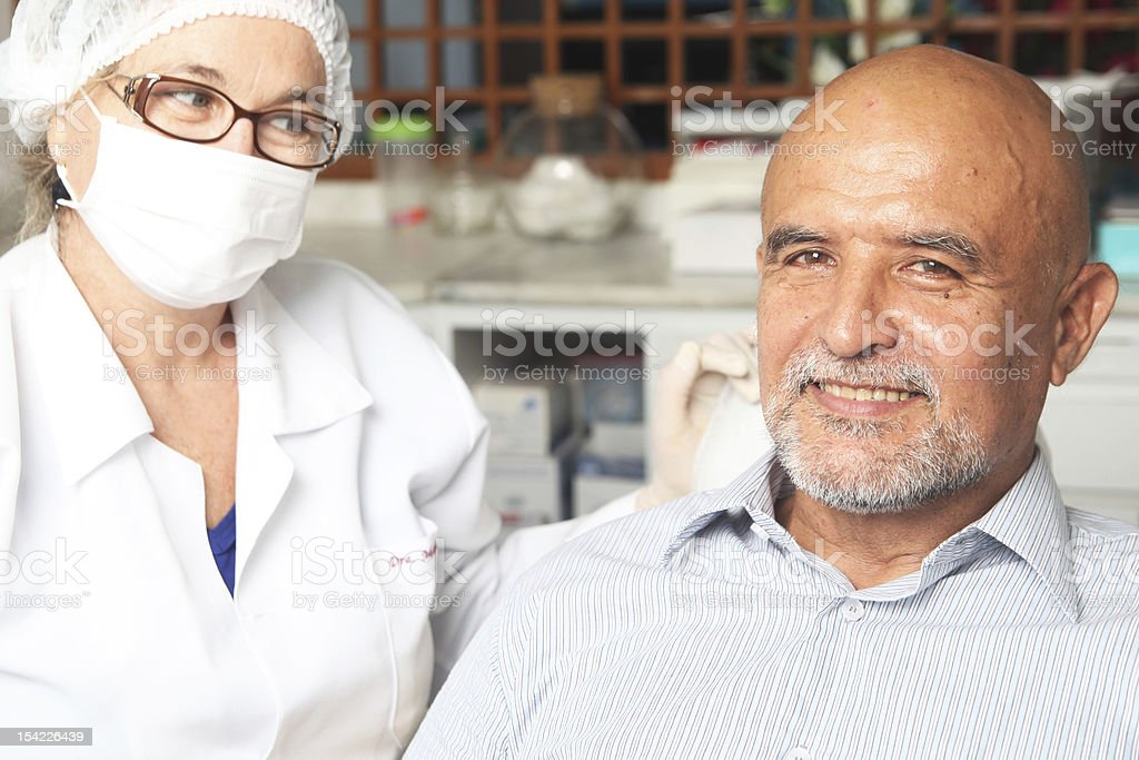 Middle aged man happy at the dentist royalty-free stock photo