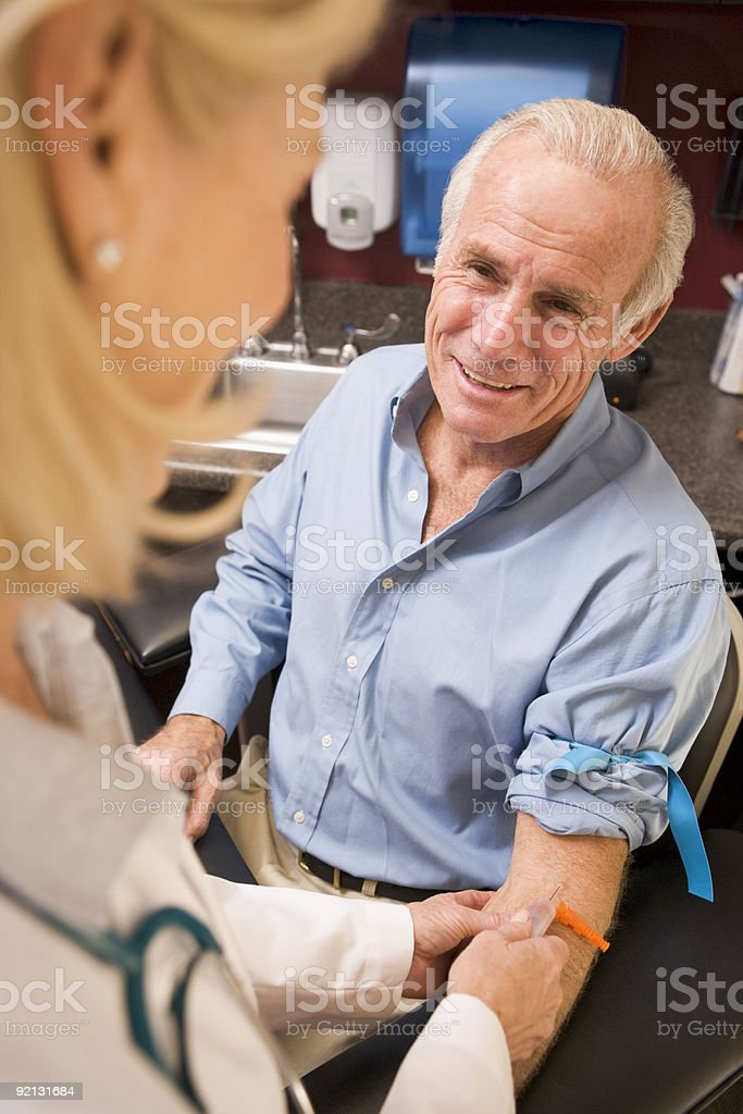 Middle Aged Man Having Blood Test stock photo