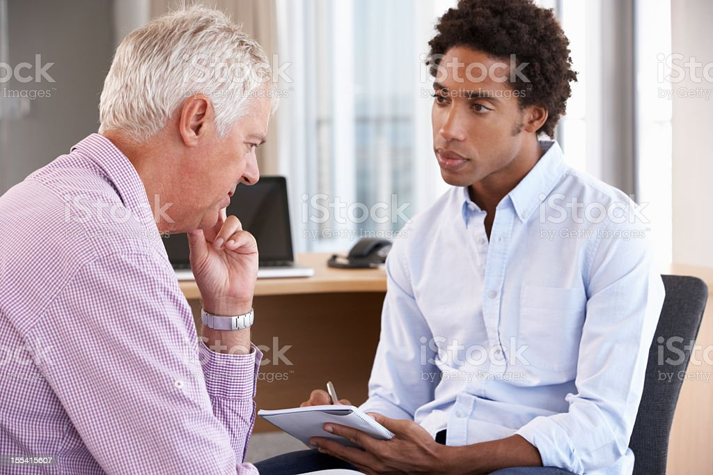 Middle Aged Man Having Counselling Session stock photo