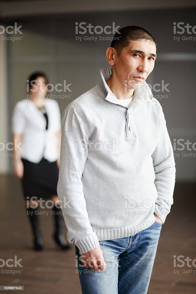 Middle aged man in casual clothes with short hair thoughtfully stock photo