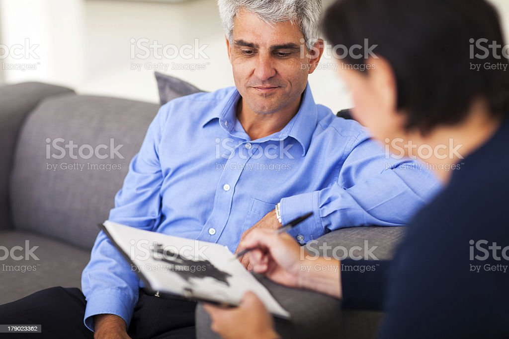 middle aged man in session with therapist stock photo