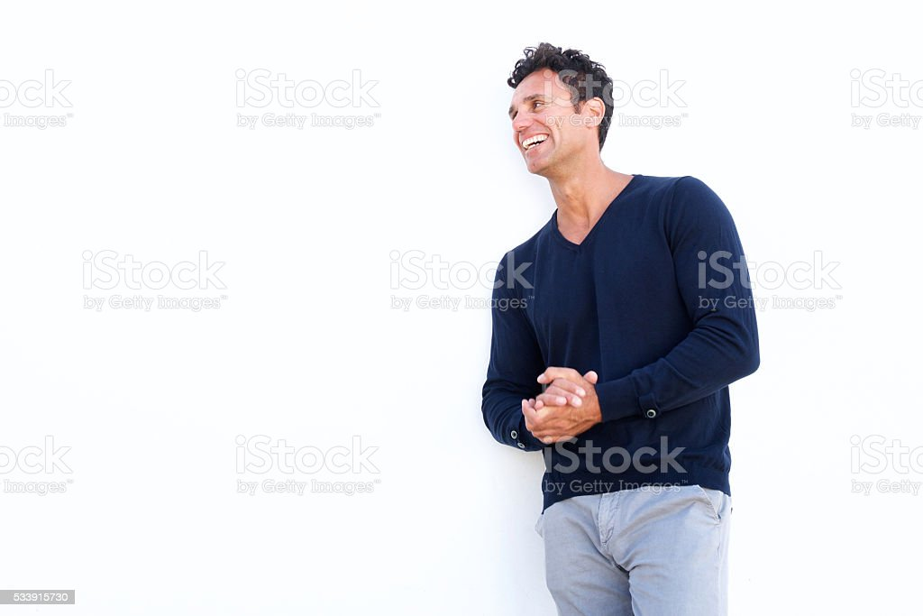 Middle aged man laughing against isolated white background stock photo