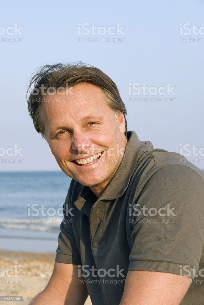 A middle aged man laughing on the beach royalty-free stock photo