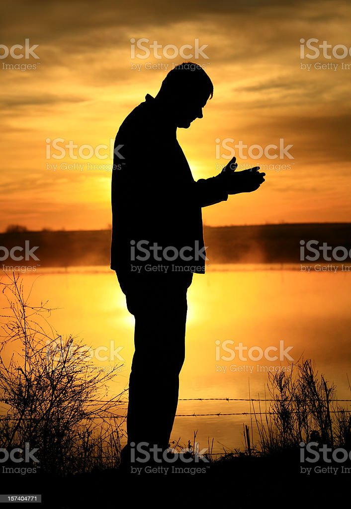 Middle aged man meditating and sunset. royalty-free stock photo