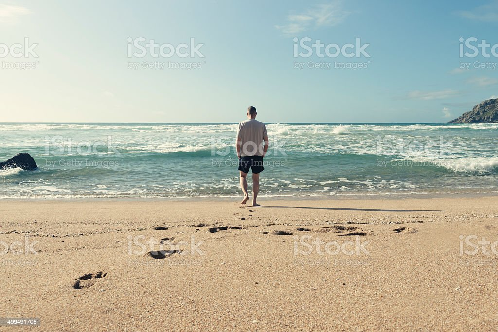 Middle aged man on a beach stock photo