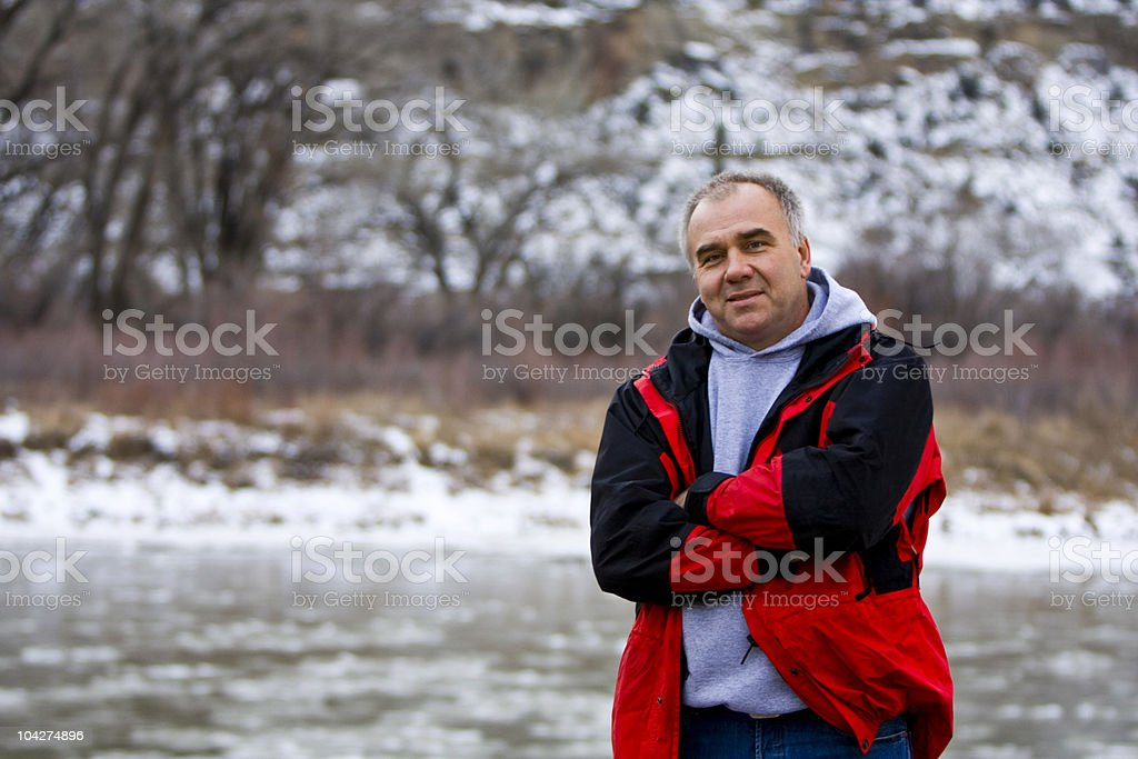 Middle Aged Man Outside By Frozen River royalty-free stock photo
