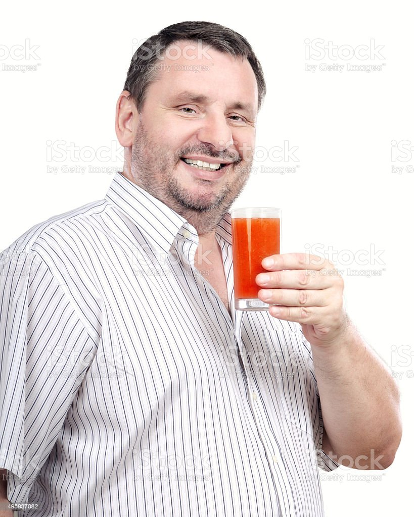 Middle aged man promoting a detox drink stock photo