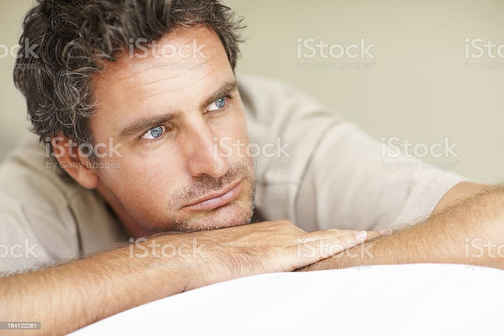 Middle aged man relaxing on bed royalty-free stock photo