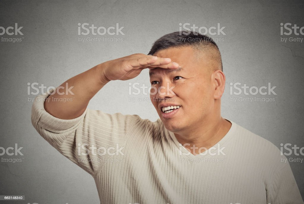 middle aged man searching looking far away into future stock photo