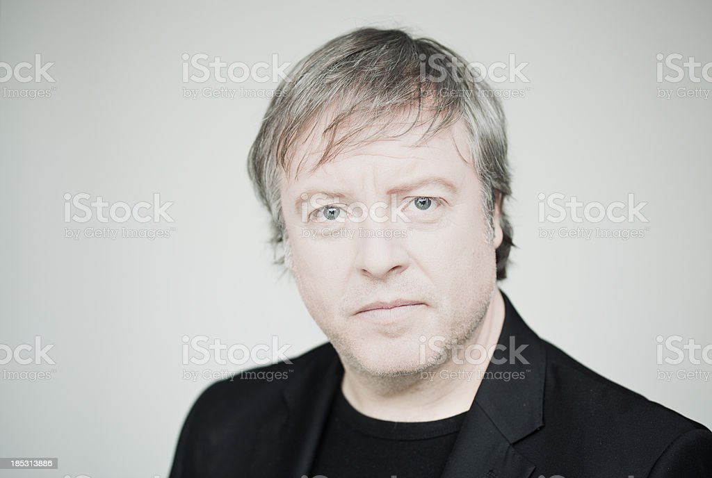 Middle aged man serious head and shoulders portrait stock photo