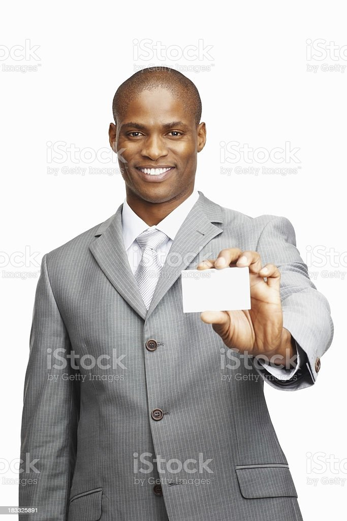 Middle aged man showing a business card against white background royalty-free stock photo