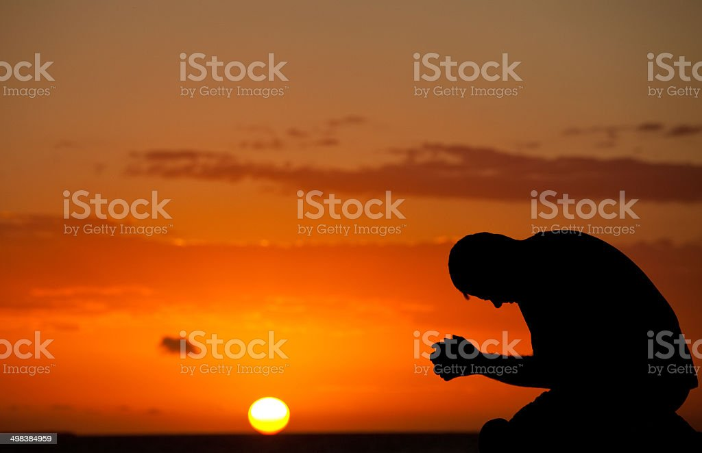 Middle Aged Man Side View Prayer Silhouette stock photo