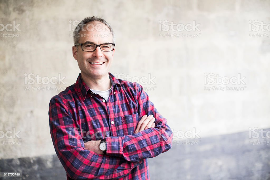 Middle aged man smiling and looking at camera. stock photo
