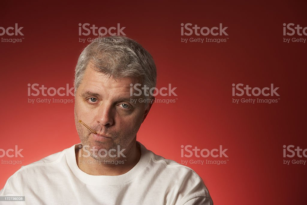 middle aged man thermometer in mouth with flu symptons royalty-free stock photo