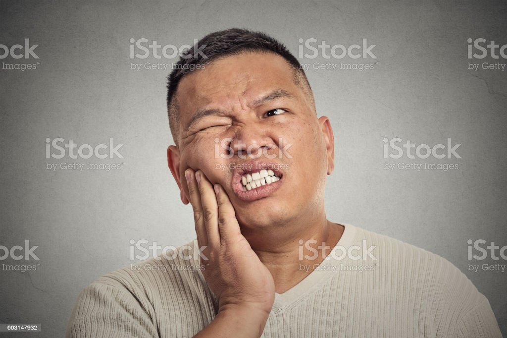 middle aged man touching face having bad pain, tooth ache stock photo
