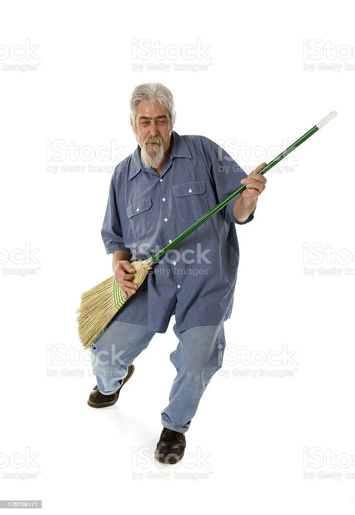 Middle Aged Man Using Broom as Guitar stock photo