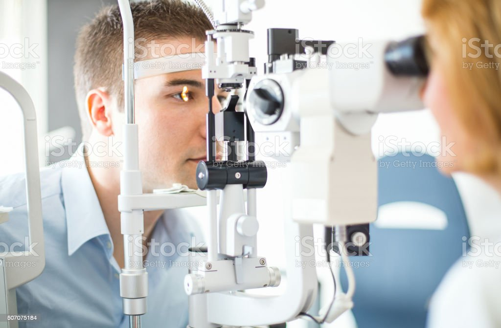 Middle aged man visiting optician. stock photo